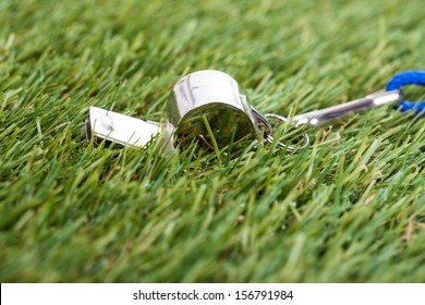 Close-up Of Whistle On The Green Field