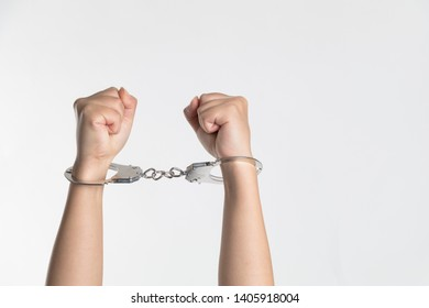 close-up, white arms in handcuffs - isolated on grey background - white man in handcuffs - arrested person