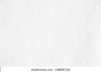 Closeup white blank paper napkin with grooved surface texture background.