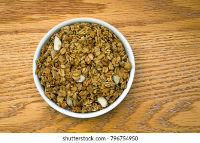 Closeup of a White Bowl Full of Healthy Granola