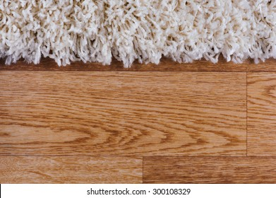 closeup of white carpet on a wood surface