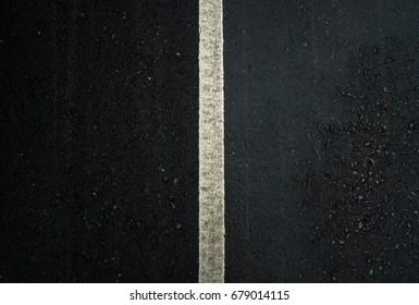 Closeup white center line on road