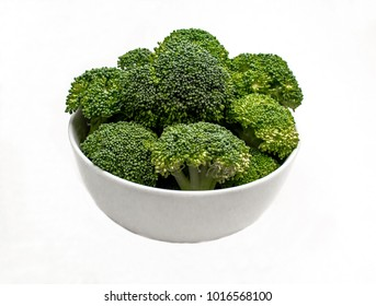 Closeup of a White Ceramic Bowl of Fresh Green Broccoli on a white background