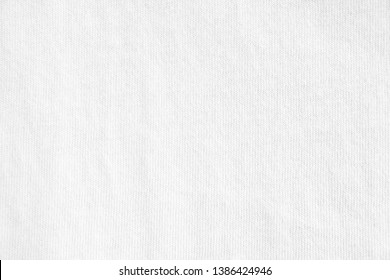 Closeup white crumpled textile texture background. Horizontal picture.