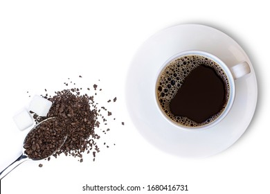 Closeup white cup of hot black coffee and instant granular coffee in stainless teaspoon with sugar cubes isolated on white background. Top view. Flat lay