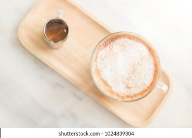 Closeup white cup hot milk cappuchino coffee with smoke on wooden table. Love hot drink cappuchino freshness and aroma in morning. lifestyle and relaxation concept.