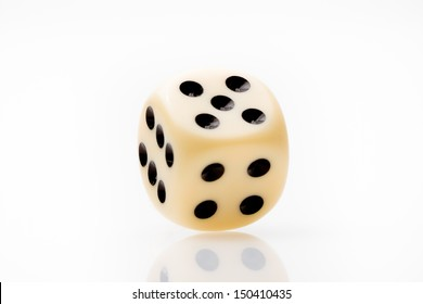 closeup of  white dice on white table