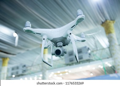 A closeup of a white drone flying inside a building hall in Bengaluru,India on June 6,2018