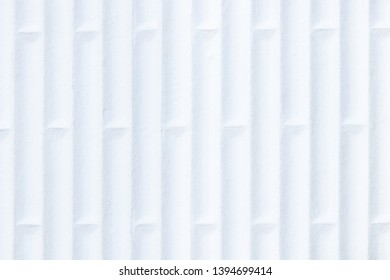 Close-up of white flip flop rubber sole profile with abstract pattern of vertical lines and alternating horizontal lines. High key exposure.