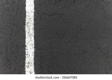 Close-up of white parking line painted on newer pavement