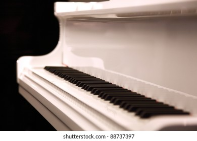 Closeup of a white piano, shallow depth