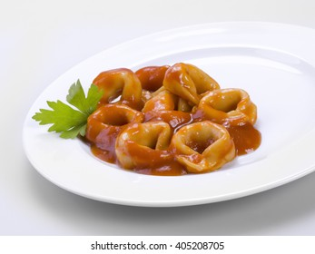 Closeup of a white plate with pasta called tortellini