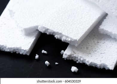 Closeup white polystyrene foam. Polystyrene foam is cushioning material in packaging, material for craft applications and other.