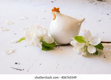 Closeup of white porcelain chicken on white background