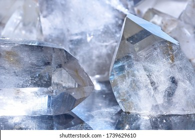 Close-up of white quartz stone crystals on polished slab. Group of quartz crystals as a background. Texture of quartz crystals.