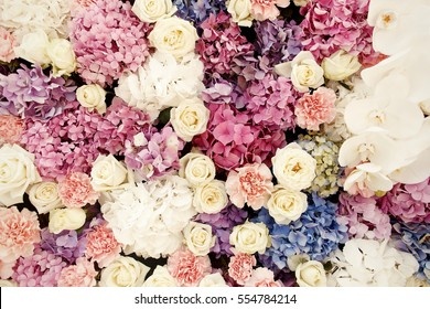 Close-up of white roses and hydrangeas put in a wall of flowers