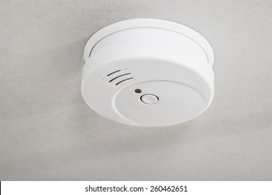 Close-up Of White Smoke Detector On A Ceiling