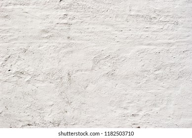 closeup of white textured plaster wall at exterior of building