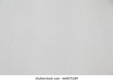 Closeup of white textured wall