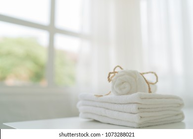 Close-up white towel on white table, Spa towel folded with window light