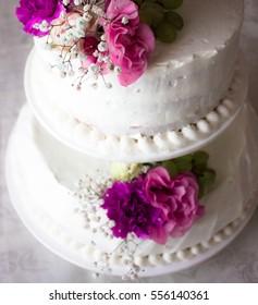 Closeup white wedding cake flowers on stock photo edit now closeup of white wedding cake with flowers on top cake on the cake shelf mightylinksfo