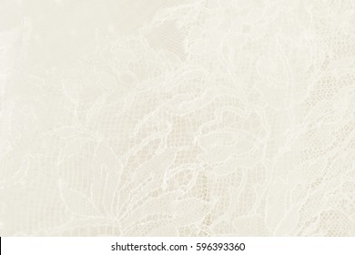 Closeup of white wedding lace with floral pattern