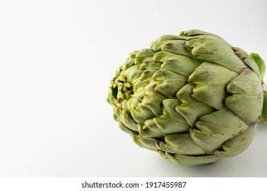 Close-up of whole artichoke, on white background, horizontal, with copy space