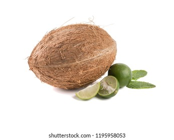 Close-up of a whole coconut and sliced lime with mint isolated on a white background. A concept of exotic fruits.