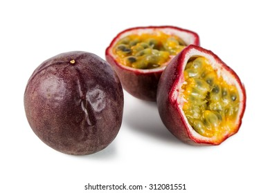 Close-up of a whole and split passion fruits (passionfruit, purple granadilla (Passiflora edulis)) isolated on white background.