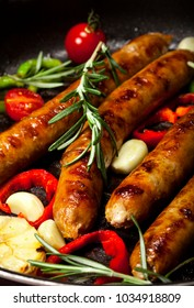 Closeup of Wiener Sausages with vegetables in a pan