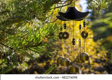 Closeup wind chimes in autumn garden (happiness, success, power, wealth)