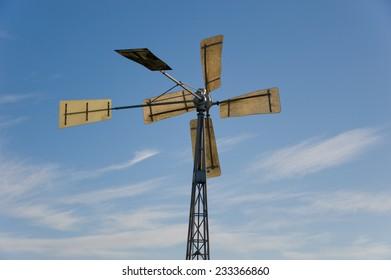 Closeup of a wind turbine against a blue sky
