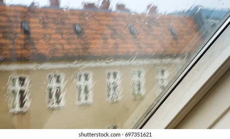 closeup of window of apartment with rain on it