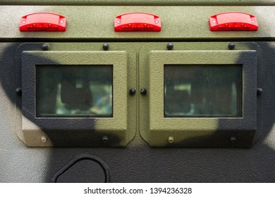 Closeup window and signal lights on military armored vehicle made with solid steel.