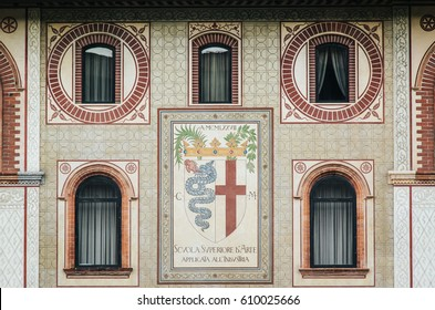 Closeup windows and emblem details of Sforza Castle (Palazzo Sforzesco), one of the main landmarks and tourist attractions of Milan, Italy.