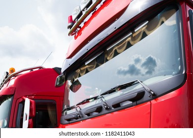 closeup of a windshield of a red truck
