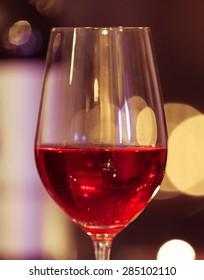 Closeup of wine glass.