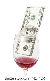 Closeup of wine glass with cracked bottom and one hundred dollar bill inside isolated on white