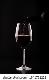 closeup wine glass filling silhouette