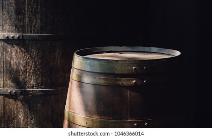 Closeup of wine wooden barrel in the old cellar of the winery, with blank copy space
