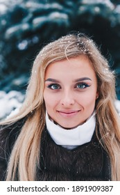Close-up winter portrait of young woman with blond hair