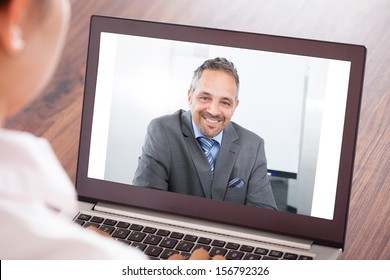Close-up Of Woman Attending Video Conference On Laptop