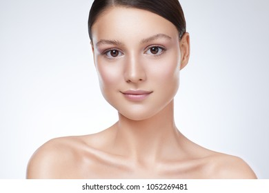 Close-up woman beauty portrait,  Clean soft make up and white background.