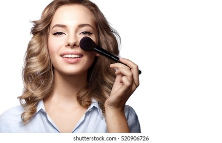 Close-up of a woman with a brush for make-up powder