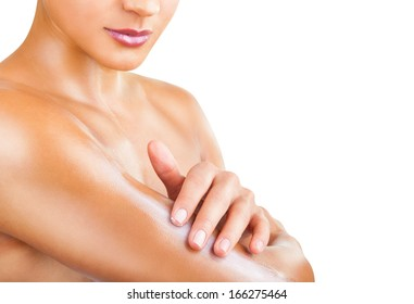 Close-up woman caring about her arm applying cosmetic cream isolated on a white background