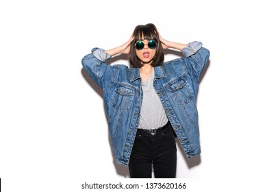 Closeup woman casual outfits standing in jeans and blue denim shirt, women brown hair and short, smiling and wearing sunglasses.