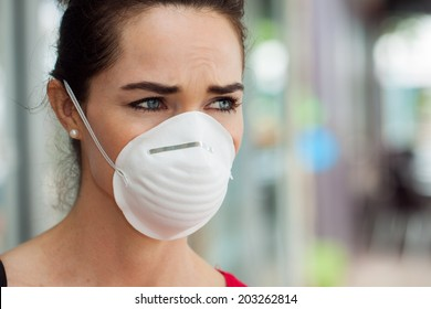 Close-up of a woman in the city wearing a face mask to protect herself from infection or air pollution.