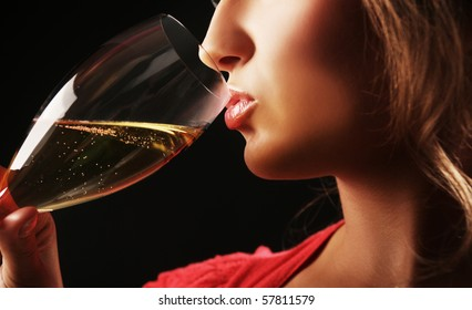 close-up of woman drinking champagne