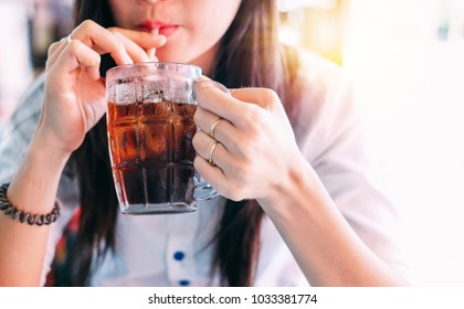 closeup woman drinking ice cola in the glass.food and beverage concept.