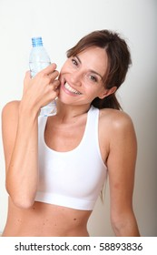 Closeup of woman drinking water after exercising